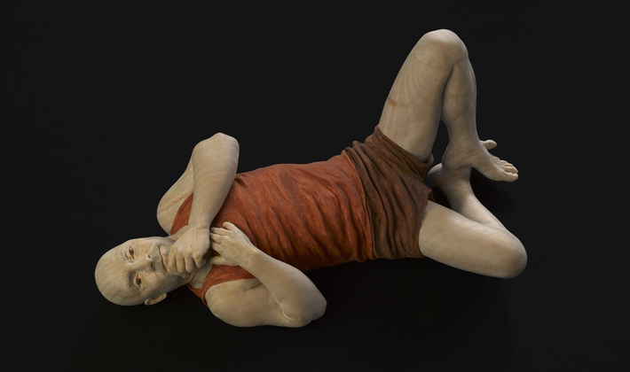 Andrew Lying down in Brown Shorts